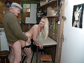 Blonde beauty in erotic black stockings and high-heel boots getting fucked by depraved grandpa and his horny buddy